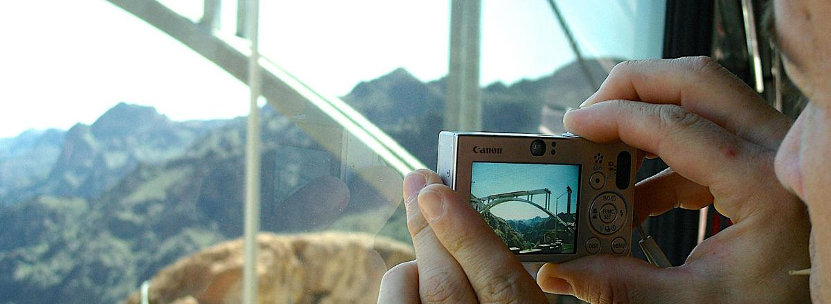 Instructor Phillip Bosshart photographing the construction of the Hoover Dam's arch bridge.